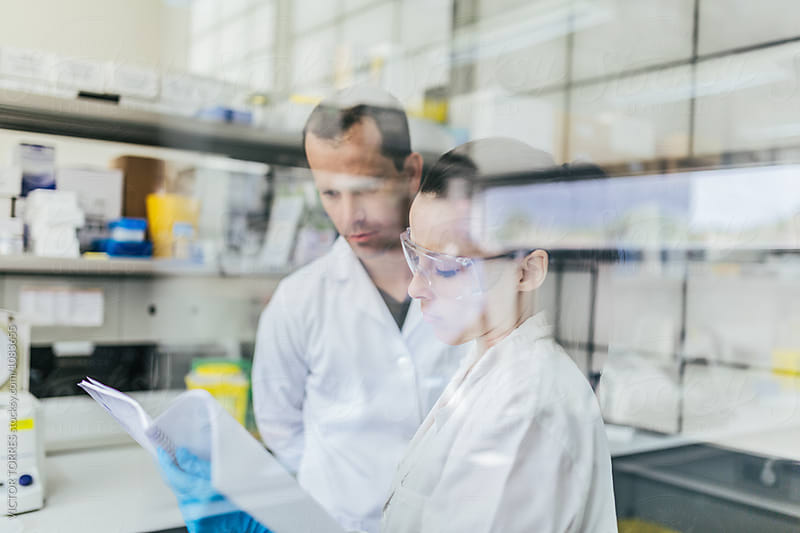 Young Researchers Working in a Professional Laboratory by Victor Torres for Stocksy United