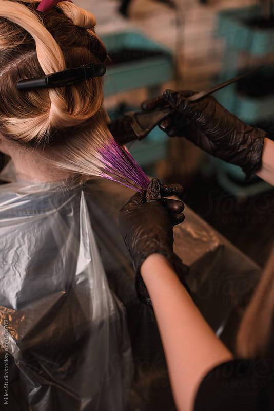 Hairdresser dyeing girl's hair by Milles Studio for Stocksy United