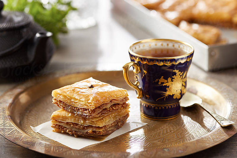 Baklava on decorative tray with cup of tea by Martí Sans for Stocksy United