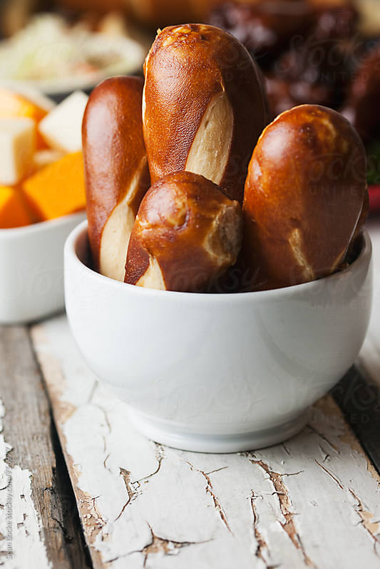 Football: Bowl Of Pretzel Bread Sticks And Other Football Snacks by Sean Locke for Stocksy United