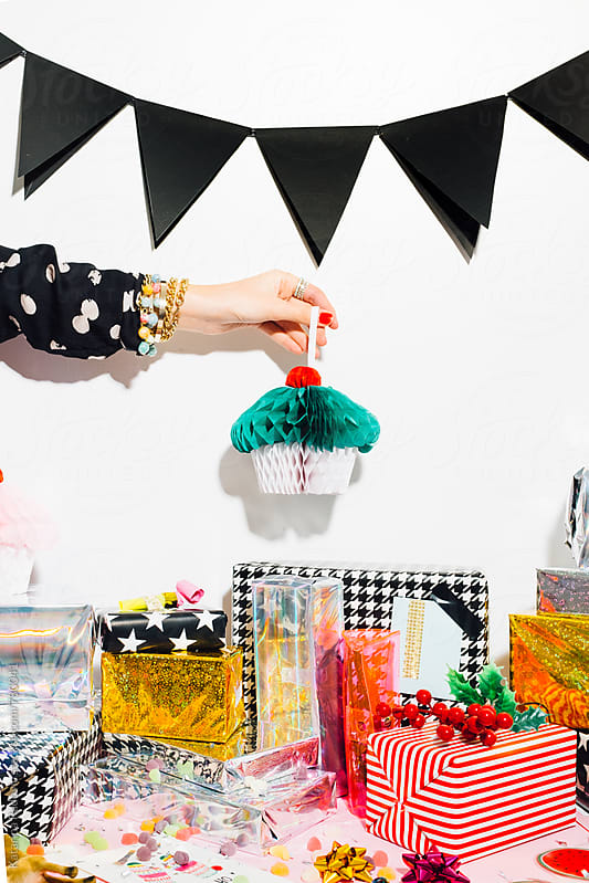 Woman Holding Paper Cupcake as a Party Decoration by Katarina Radovic for Stocksy United