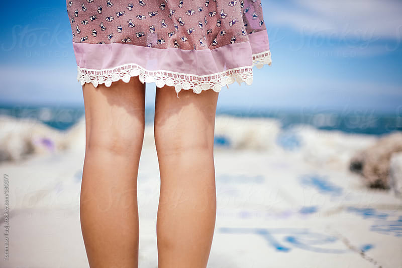 legs of young girl by Tommaso Tuzj for Stocksy United