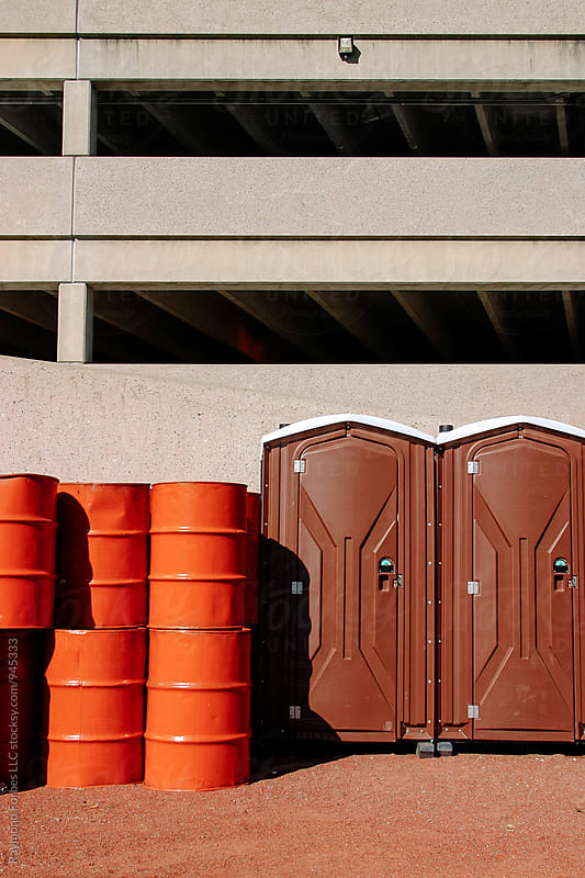 Portable Toilet outside football Stadium by Raymond Forbes LLC for Stocksy United