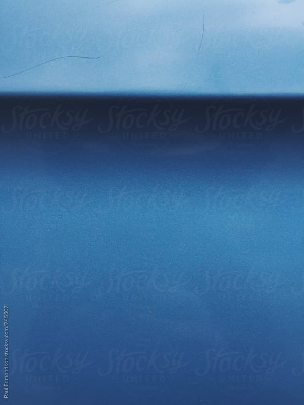Painted blue car door, close up by Paul Edmondson for Stocksy United