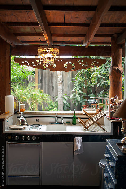 Rustic outdoor kitchen in backyard. by Robert Zaleski for Stocksy United