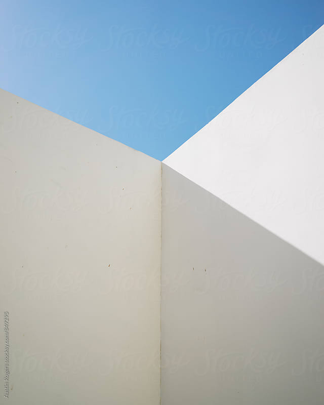 Minimalist Photo of Stark White Wall Against Blue Sky by Austin Rogers for Stocksy United