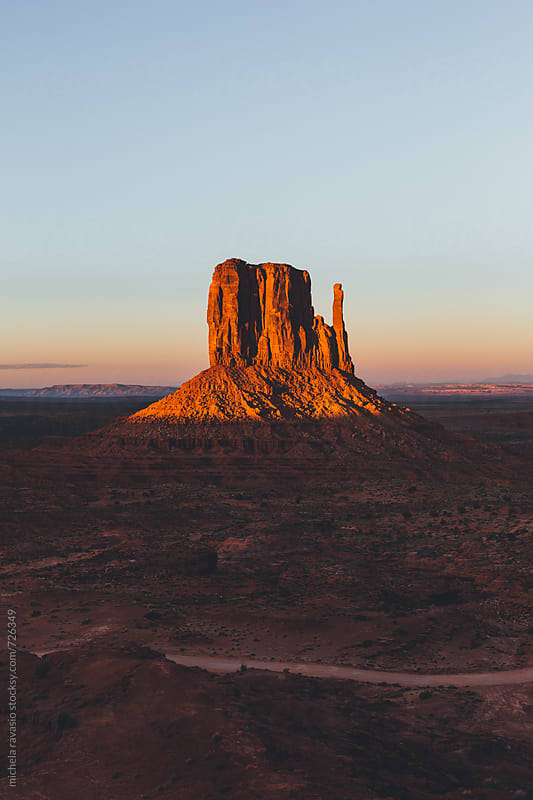 View of West Mitten in Monument Valley at sunset by michela ravasio for Stocksy United