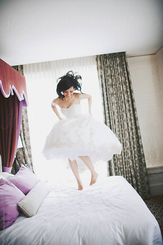 Bed Jumping Bride by Kevin Russ for Stocksy United