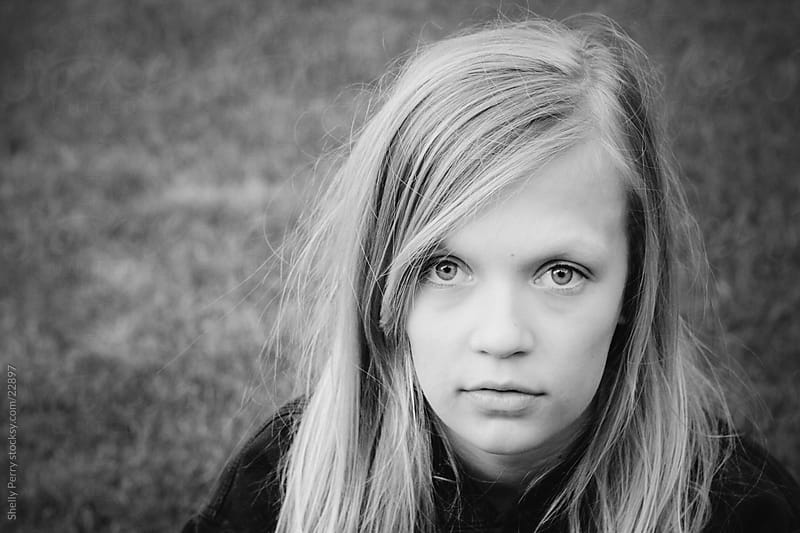 Portrait of a Blond Girl with a Serious Expression  by Shelly Perry for Stocksy United