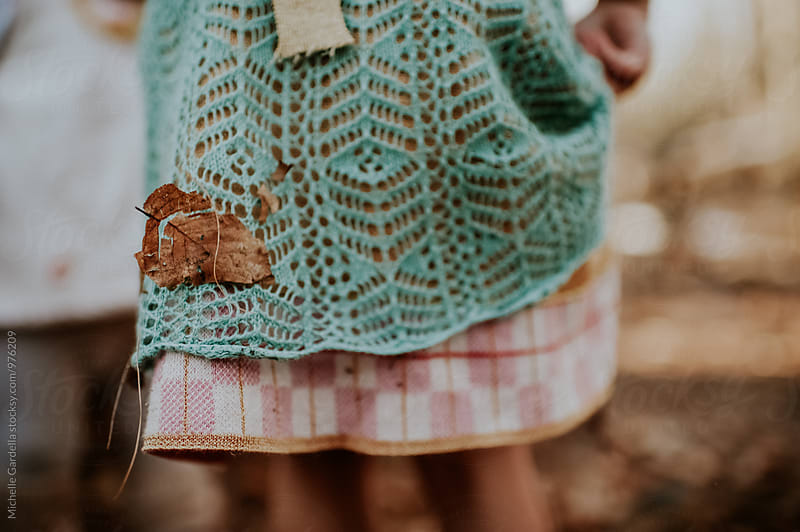 leaves on the dress by Michelle Gardella for Stocksy United
