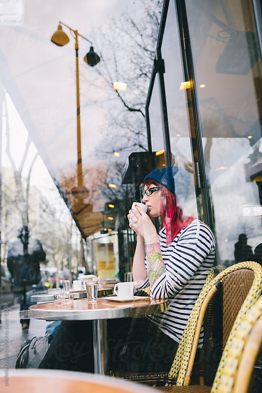 Young woman at the cafè by michela ravasio for Stocksy United