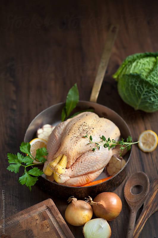 preparing raw chicken  by Lee Avison for Stocksy United