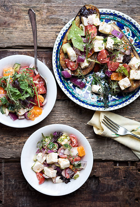 Roasted aubergine and feta salad. by Darren Muir for Stocksy United