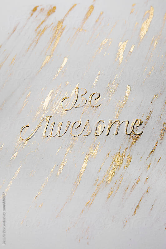 Handmade letterpress message: be awesome with golden paint by Beatrix Boros for Stocksy United