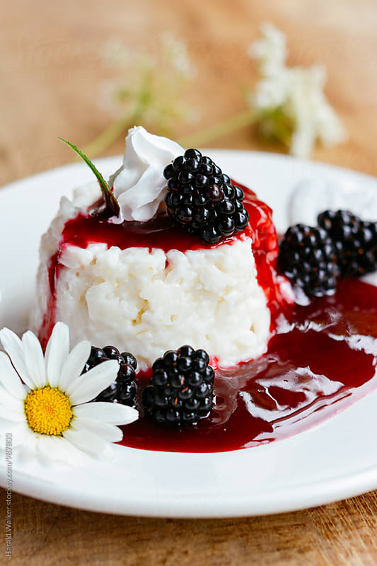 Almond Rice Pudding with Blackberry Sauce by Harald Walker for Stocksy United