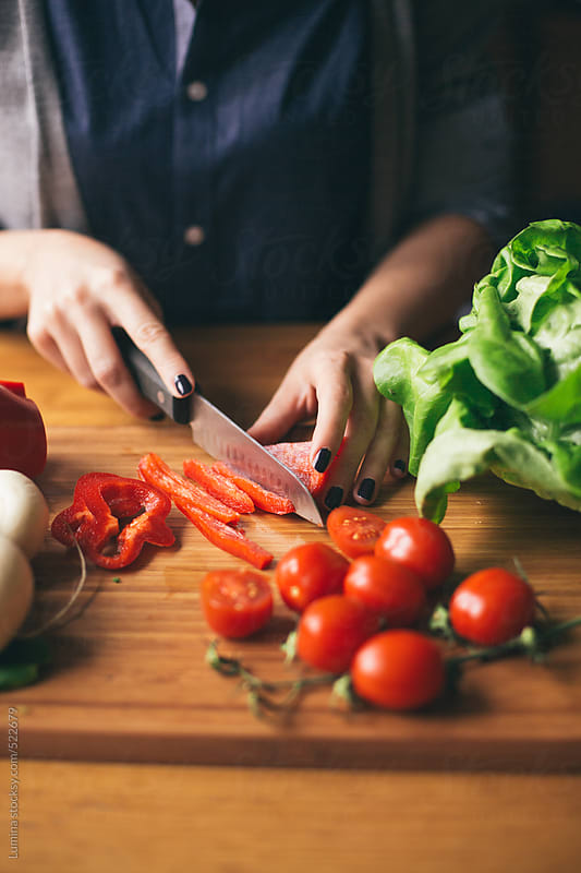 Woman Chopping Vegetables  by Lumina for Stocksy United