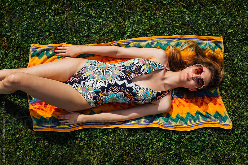 Beautiful Young Woman in Bikini Lying on a Grass by Katarina Radovic for Stocksy United