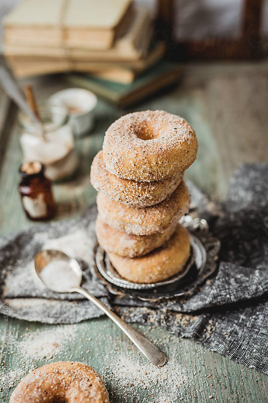 Donuts with cinnamon and sugar by Tatjana Zlatkovic for Stocksy United