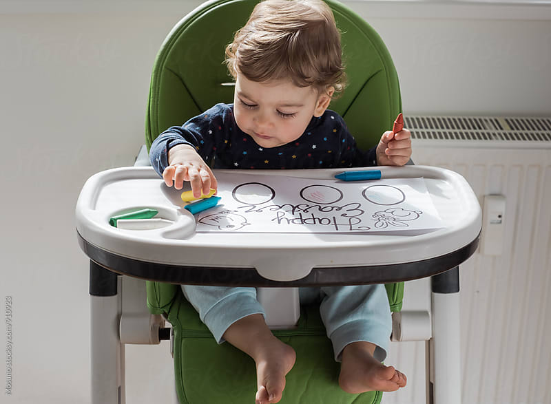 Child Colouring in a Feeding Chair by Mosuno for Stocksy United