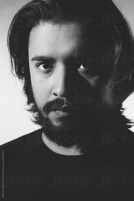 Black and white portrait of a bearded man. by Shikhar Bhattarai for Stocksy United