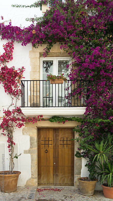 Flowers decoration of facade, typical house in Spain by ACALU Studio for Stocksy United