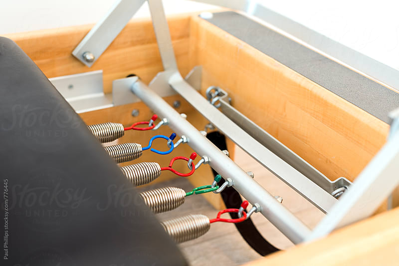 Coloured springs at the base of a Pilates Reformer by Paul Phillips for Stocksy United
