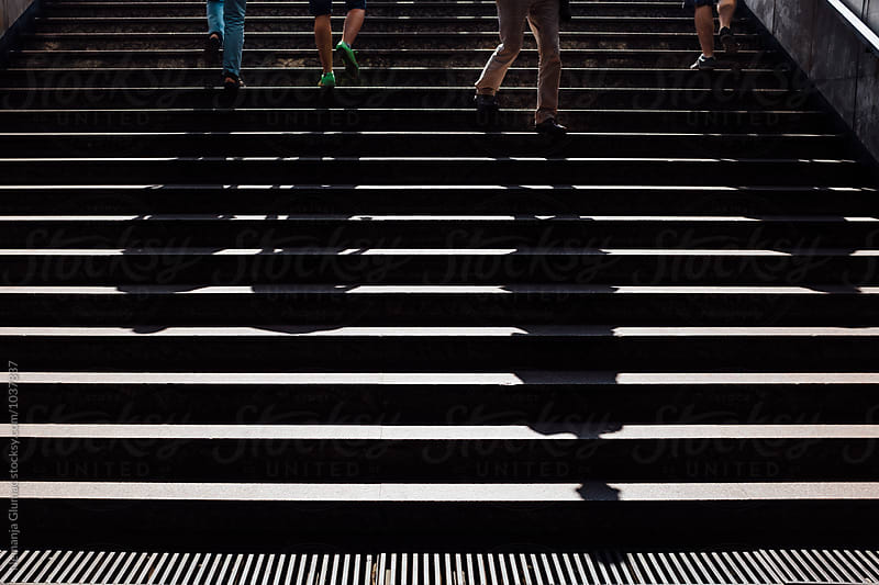 People Climbing up from Metro Station in Budapest by Nemanja Glumac for Stocksy United