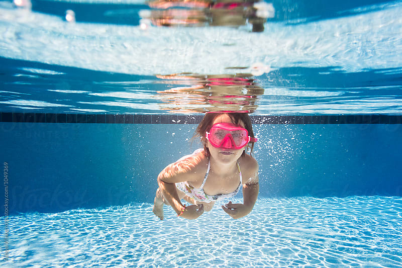 A Child Swimming Under The Water by Alison Winterroth for Stocksy United