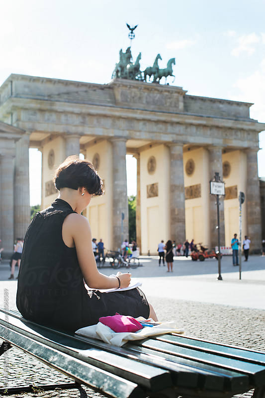 Berlin - Young Female Artist Drawing Outdoors Near Brandenburg Gate by Julien L. Balmer for Stocksy United