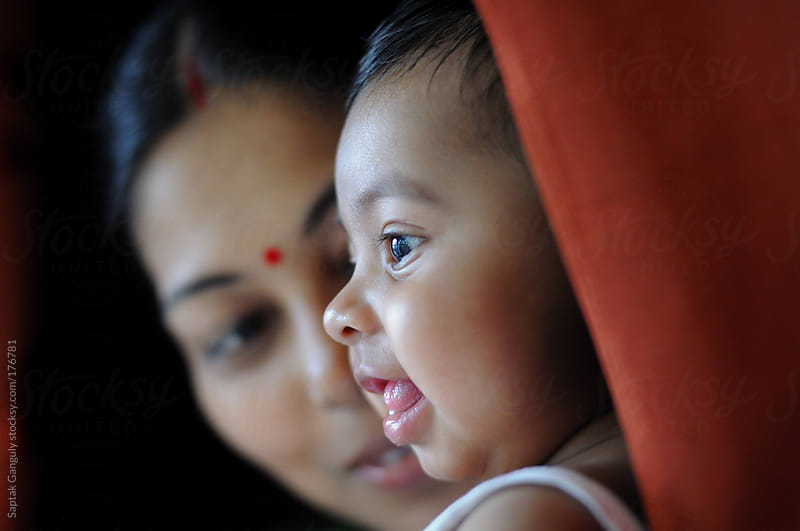 Cute baby girl with her mother smiling by Saptak Ganguly for Stocksy United
