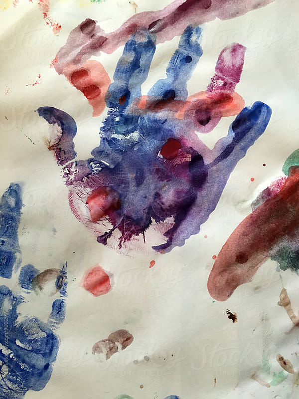 Childs hand print on paper 3 year old by Paul Phillips for Stocksy United