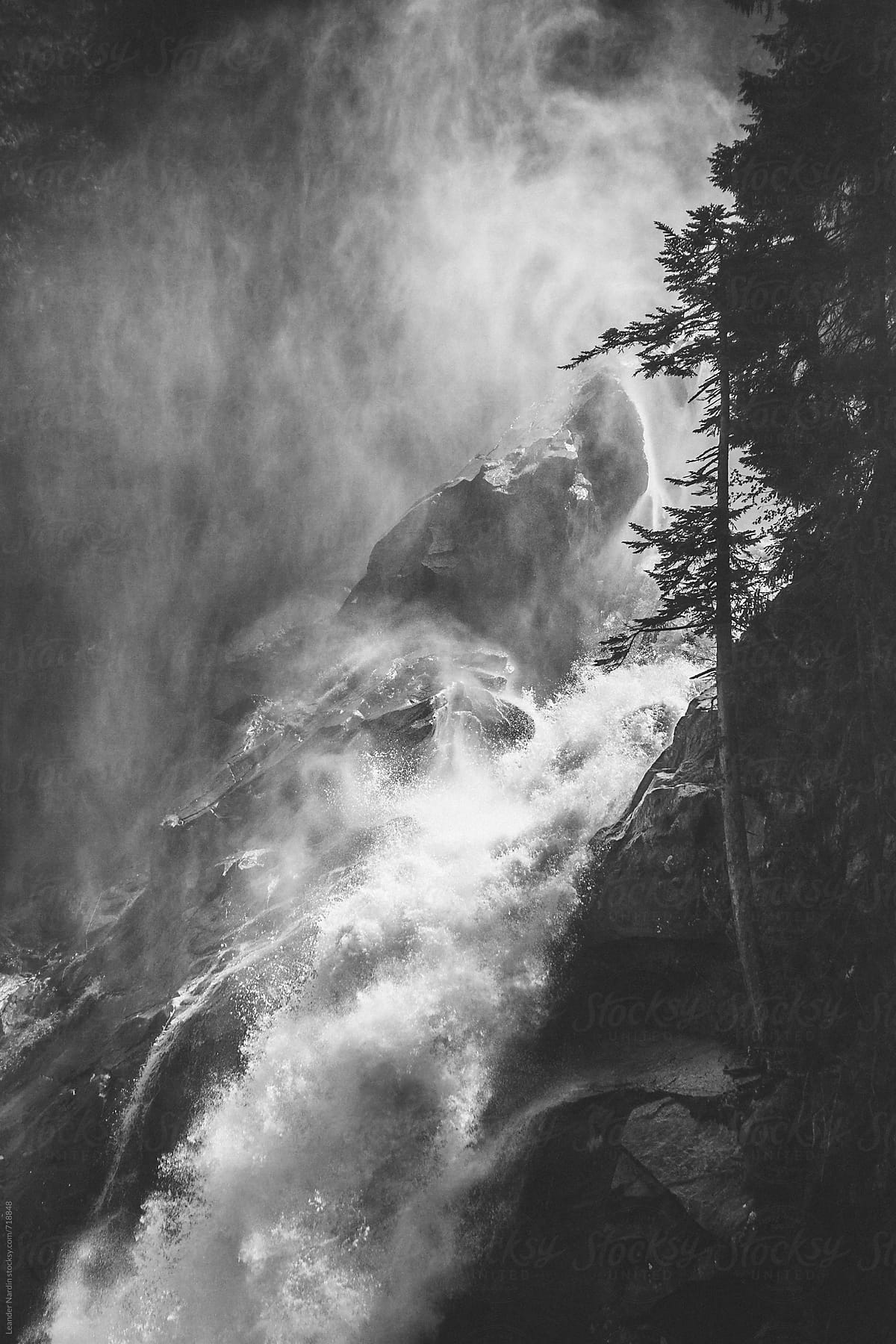 Detail of a powerful river flowing down a mountain black and white