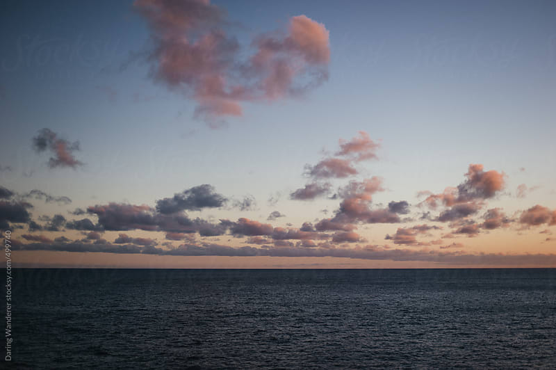 Sunset over the North Pacific Ocean in Oahu, Hawaii by Daring Wanderer for Stocksy United