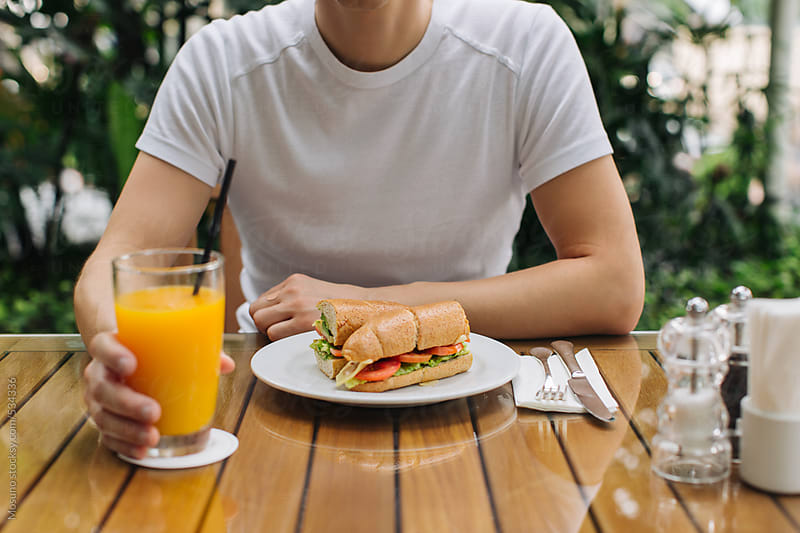 Man Eating Breakfast in Cafe by Mosuno for Stocksy United