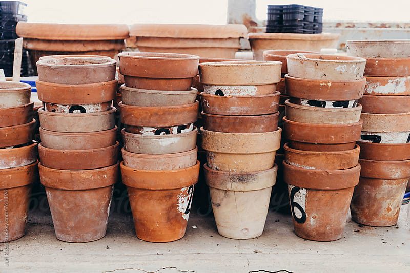 group of empty terracotta pots by Juri Pozzi for Stocksy United