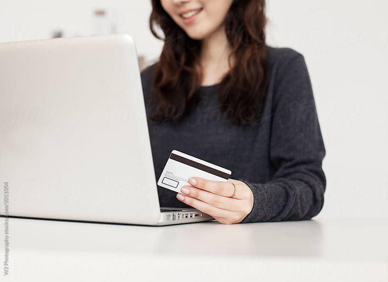 Online shopping payment with credit card by W2 Photography for Stocksy United