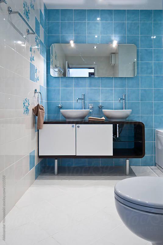 Modern blue bathroom by Aleksandar Novoselski for Stocksy United