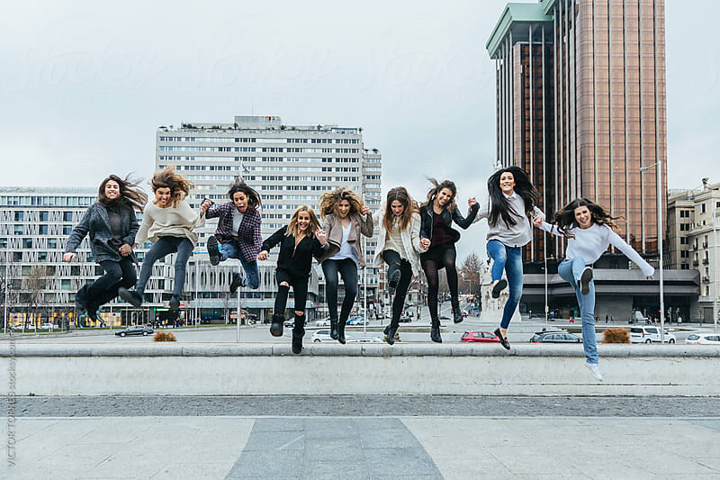 Group of Girls Jumping in the Street by VICTOR TORRES for Stocksy United