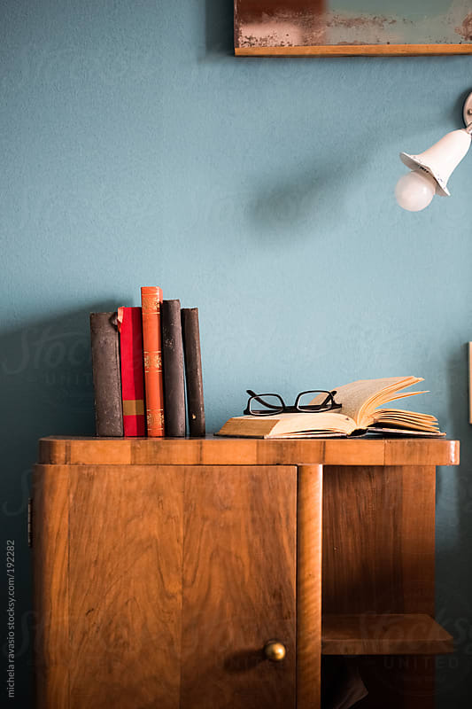 Bedside table with books and glasses by michela ravasio for Stocksy United