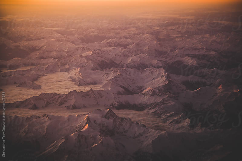 Flying over the rocky mountains by Christopher Troy Dowsett for Stocksy United