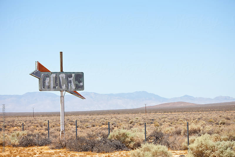 Abandoned cafe sign in Mojave Desert by Thomas Hawk for Stocksy United