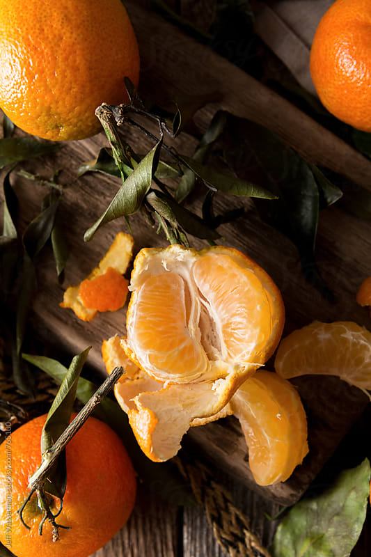 Mandarin Oranges Torn Open in Still Life by Jeff Wasserman for Stocksy United