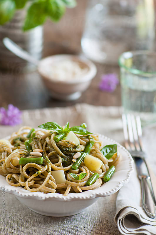 a plate of spaghetti with pesto  by Laura Adani for Stocksy United