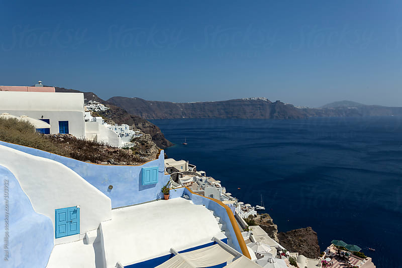Blue and white wall surrounding steps. Oia, Santorini by Paul Phillips for Stocksy United