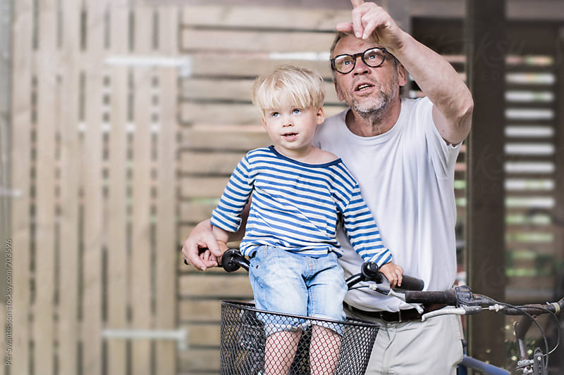 Young boy with his grandfather by Per Swantesson for Stocksy United