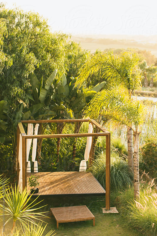A pergola among luscious greenery by Maresa Smith for Stocksy United