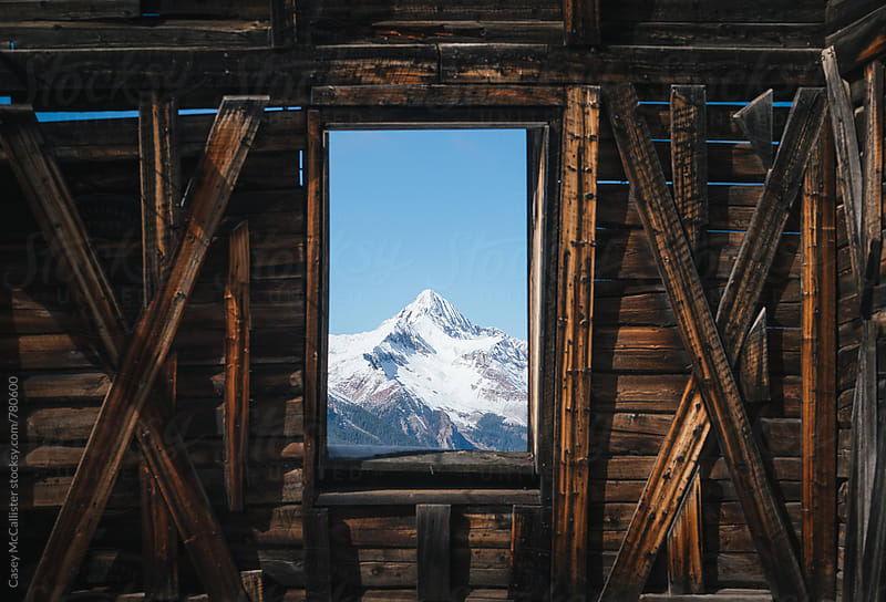 Window to the Rocky Mountains by Casey McCallister for Stocksy United