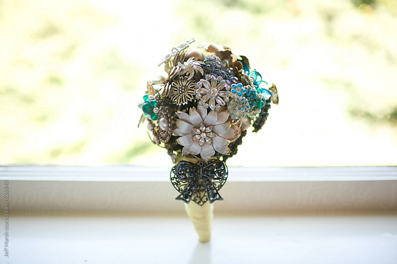 Bride holding baroque flower boquet by Jeff Marsh for Stocksy United