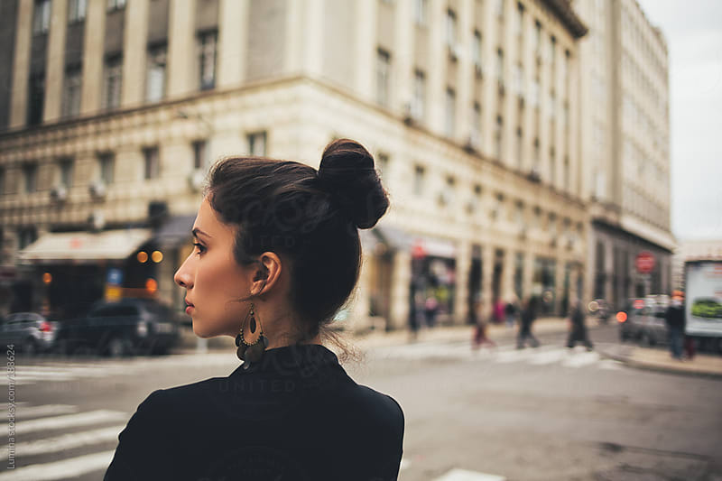 Portrait of a Woman on the Street by Lumina for Stocksy United