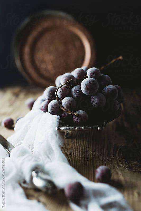 Frozen grapes by Tatjana Zlatkovic for Stocksy United